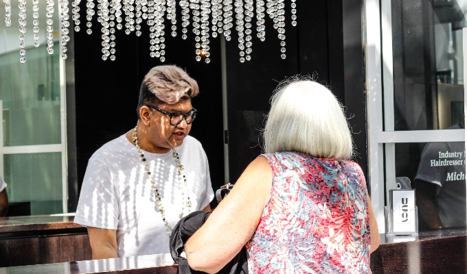 Hair salon client paying for service at front desk