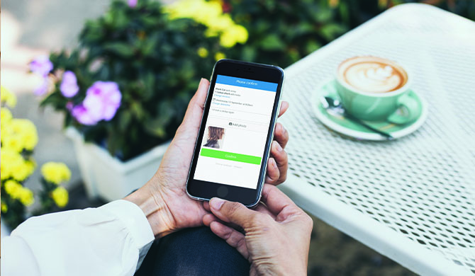 Person paying deposit online for appointment on smartphone