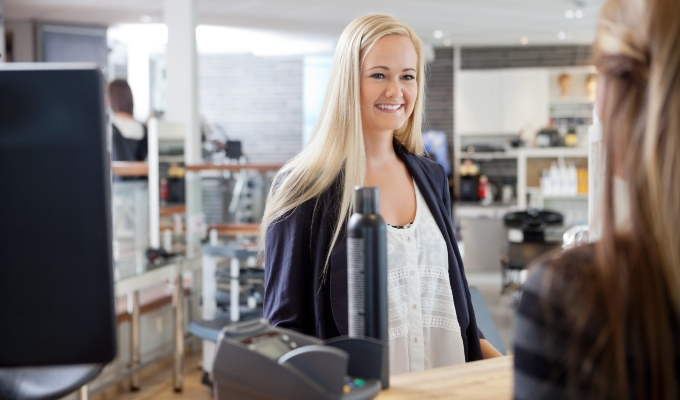 woman buying hair product in salon