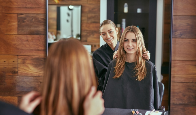 Hair stylist with client