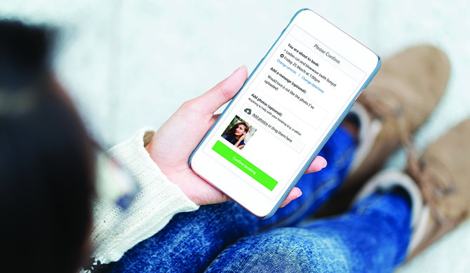Woman booking hair appointment on smartphone