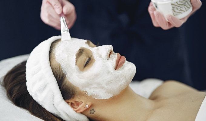 Facial being performed on client