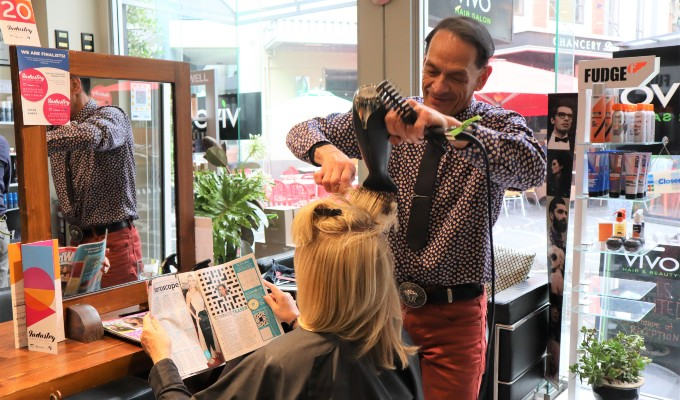 Vivo salon stylist and manager Peter doing a blow wave on a client