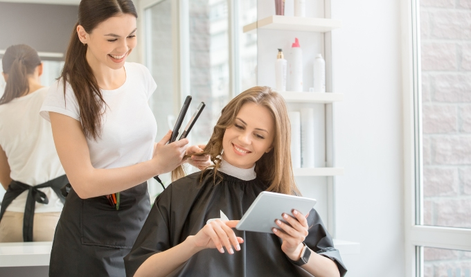 Hair salon client receiving recommendations from stylist